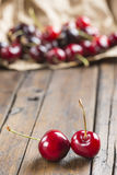 A wrapping paper with cherries on the table Stock Images