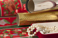 Wrapping paper with Christmas gift Royalty Free Stock Photo