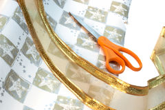 Wrapping paper, ribbon & scissors royalty free stock image