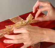 Wrapping present Royalty Free Stock Image