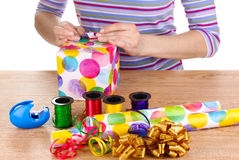 Wrapping presents surrounded by  paper Royalty Free Stock Photography