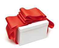 A wrapping red ribbon gift on white Stock Images