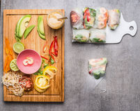 Wrapping of rice paper rolls with various chopped vegetables. Top view Stock Image