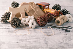 Wrapping rustic eco Christmas packages with brown paper, string. And natural fir branches on white background Stock Photo