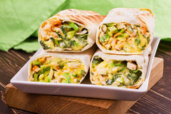 Wraps with chicken, avocado, cilantro and cheese. Chicken burrito. Stock Images