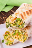 Wraps with chicken, avocado, cilantro and cheese. Chicken burrito. Royalty Free Stock Photography