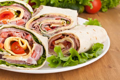 Wraps cut in half with Ingredients Stock Photos