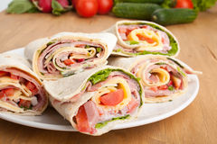 Wraps cut in half with Ingredients Stock Image