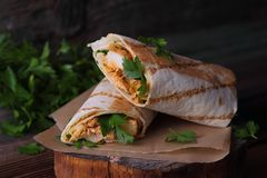 Wraps with grilled chicken and herbs Royalty Free Stock Photos