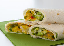 Wraps with lettuce on green napkin. Wraps with lettuce, chicken, mango and sauce on green napkin Stock Photography