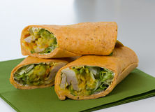 Wraps with lettuce on green napkin. Wraps with lettuce, meat and sauce on green napkin Royalty Free Stock Photography