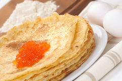 Wrapswith  red caviar Stock Photos