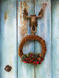 Wrath hanging infront of blue wooden door.  Royalty Free Stock Photography