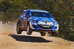 WRC dag 3 Sprong Mazda Stock Afbeelding