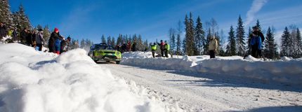 WRC panorama. HAGFORS, SWEDEN - FEBRUARY 13: Motion blurred Jarri-Matti Latvala going fast during Rally Sweden 2010 in Hagfors, Sweden on February 13, 2010 Stock Photo