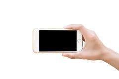 Wręcza trzymać Białego Smartphone odizolowywający z pustym ekranem Zdjęcie Royalty Free