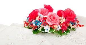 A wreath of artificial flowers. Old Ukrainian embroidery on the simple canvas and a wreath of artificial flowers Stock Photography