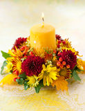 Wreath of autumn flowers and candle Royalty Free Stock Photo
