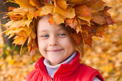 Wreath of autumn leaves on the head Royalty Free Stock Photo