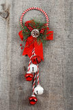Wreath and bells hanging on old wood Stock Photography