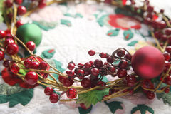 Wreath with berries on a quilt Royalty Free Stock Photos