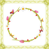 Wreath with butterflies and spring flowers in decorative frame stock images