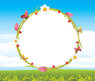 Wreath with butterflies and spring flowers on the landscape background Royalty Free Stock Images