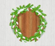 Wreath from cones and fir tree branches with round wood border on white wood background. Winter forest christmas background royalty free illustration