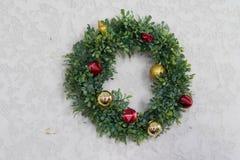 Christmas wreath decor on concrete wall stock photo