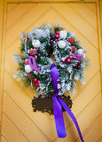 Wreath decoration at door for Christmas holiday Royalty Free Stock Photos