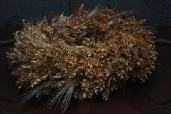 A wreath of dried flowers. Hanging on the door to the Church for Christmas Royalty Free Stock Photo