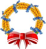 Wreath of ears and cornflower with a red bow Stock Photo