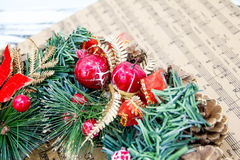 Wreath fir cones, sheet music Christmas songs concept of preparing for the holidays, turquoise shabby wooden table background. pla Stock Photography