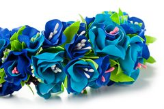 Wreath of flowers from fameirana handmade gently blue and purple on a white background.  Royalty Free Stock Photo