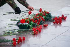 Wreath and flowers in memory of those killed in wars and armed conflicts. The memory of the victims of the war. Russia stock photography