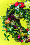 Wreath of flowers on yellow background Royalty Free Stock Images