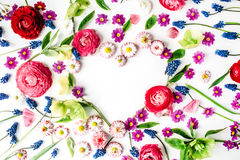 Wreath frame heart with roses, muscari, chamomile, ranunculus, branches, leaves, petals and buds isolated on white background Royalty Free Stock Photos