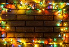 Wreath and garlands of colored light bulbs.Christmas background Stock Photography