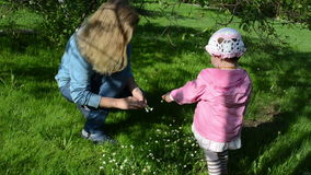 Wreath girl flower mother. Mother in the meadow weave of small floral wreath daughter picking flowers for mother stock footage
