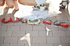 Wreath of girls on bachelorette party on pavement Royalty Free Stock Photos
