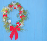Wreath hanging on a blue barn wall Royalty Free Stock Images