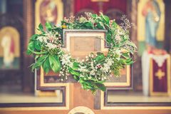 Wreath hanging on cross in church Stock Image