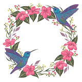 Wreath with hummingbird, tropical flowers and leaves. Exotic flora and fauna. Vintage hand drawn vector illustration in watercolor style Stock Images