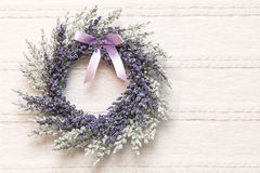 Wreath with lavender flowers on lace fabric background. Selective focus Stock Photography
