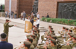 Wreath-Laying Ceremony on Holocaust Memorial Day at Yad Vashem. As an army band plays ceremonial music, in the background, people lower wreaths which are piled stock photography