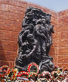 Wreath-Laying Ceremony on Holocaust Memorial Day at Yad Vashem. Flower wreaths are piled at the foot of a moving statue at Yad Vashem, the Holocaust Memorial in royalty free stock photography