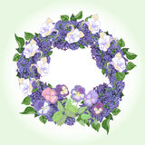 Wreath with  lilac and color pansies Stock Photo