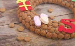 Wreath made of pepernoten on wooden background Royalty Free Stock Images