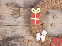 Wreath made of pepernoten on wooden background Royalty Free Stock Photos