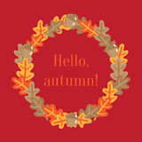 Wreath made of oak leafs with text hello, autumn Stock Photo